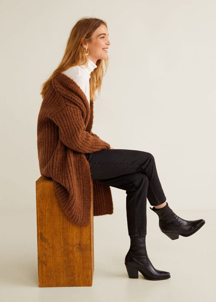 Brown chunky oversized cardigan styled with a white turtleneck
